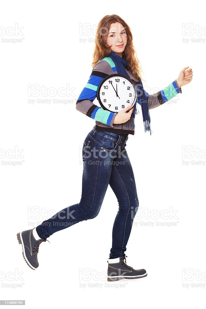 young  woman running late with clock under her arm royalty-free stock photo