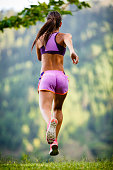 Young woman running outdoors on the country