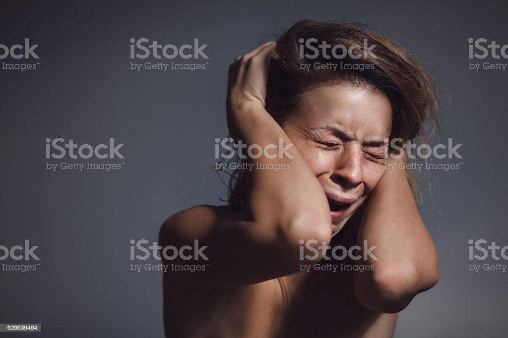 Young woman sad and crying stock photo