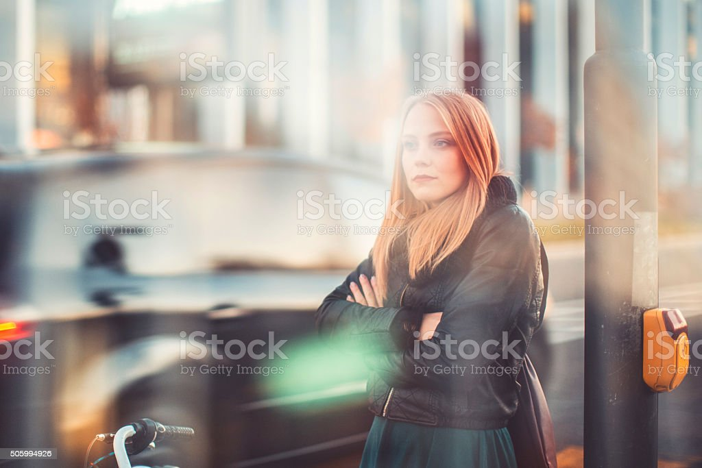 Young woman sad women, bicycle, street stock photo