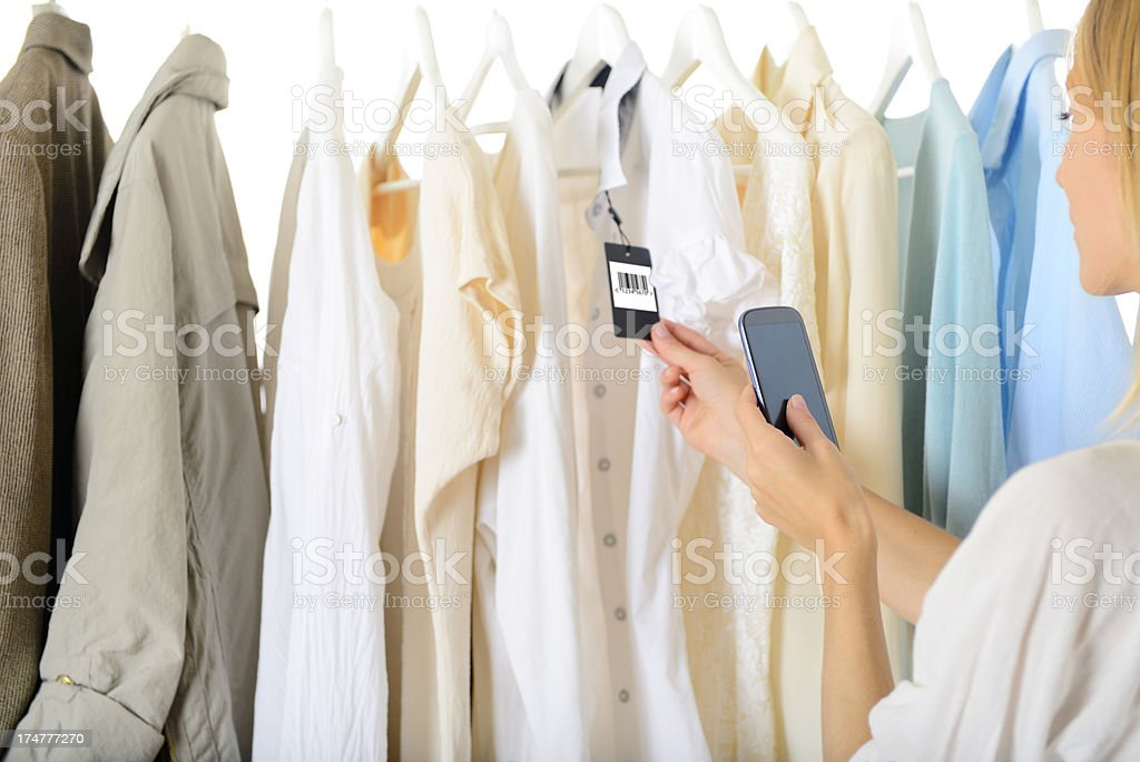 Young Woman Scanning QR Code inside Shopping Mall royalty-free stock photo
