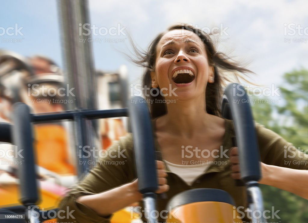 Young woman screaming on a rollercoaster royalty-free stock photo