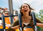Young woman screaming on a rollercoaster
