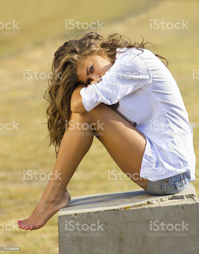 Young woman seat in nature stock photo