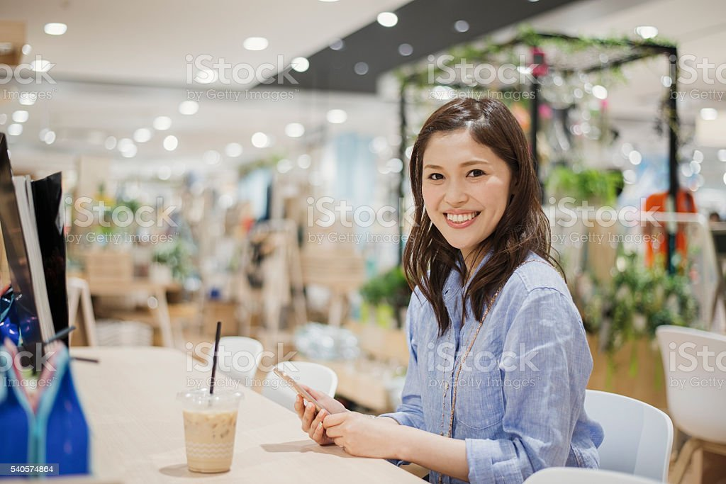 Young woman see the magazine in a cafe. stock photo