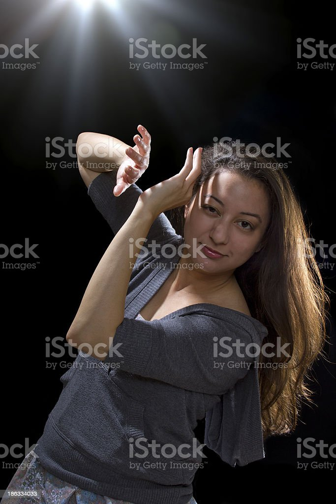 Young woman seeing bright glowing orbs from above stock photo