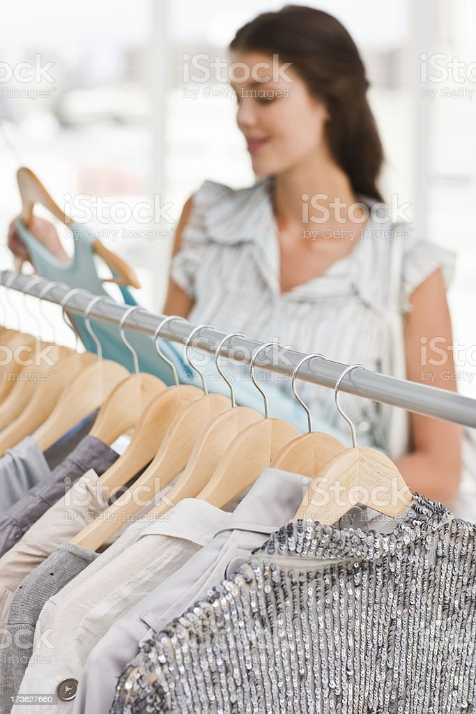Young woman selecting clothes in shop royalty-free stock photo