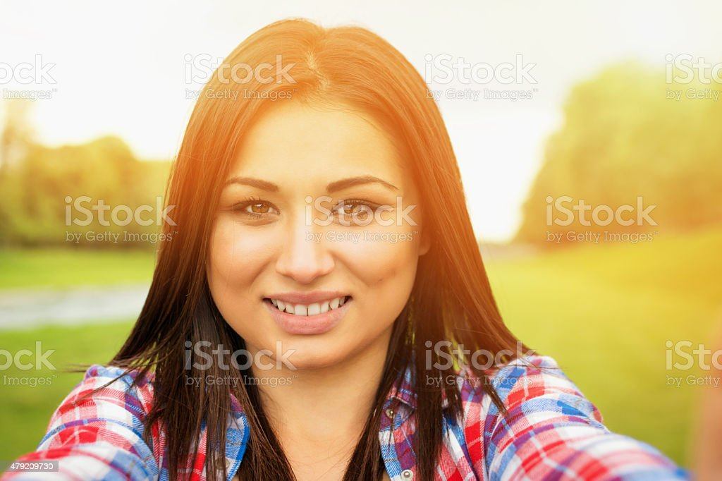 Young woman selfie outdoors stock photo