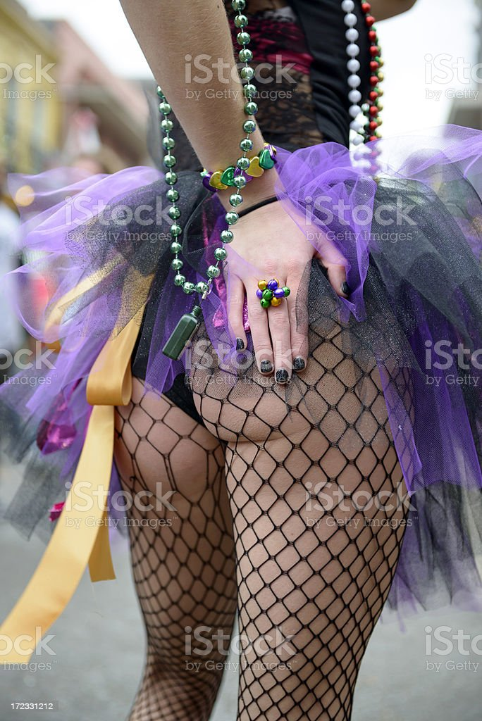 Young woman sexy Mardi Gras outfit with stockings royalty-free stock photo