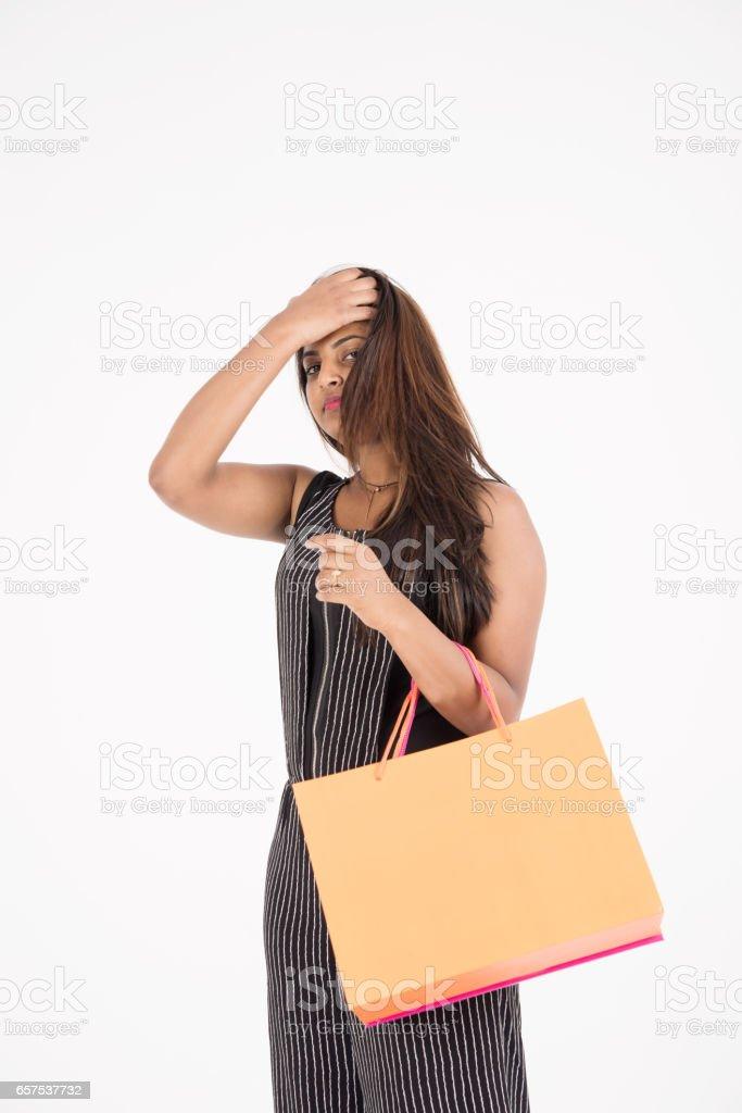young woman shoppin stock photo