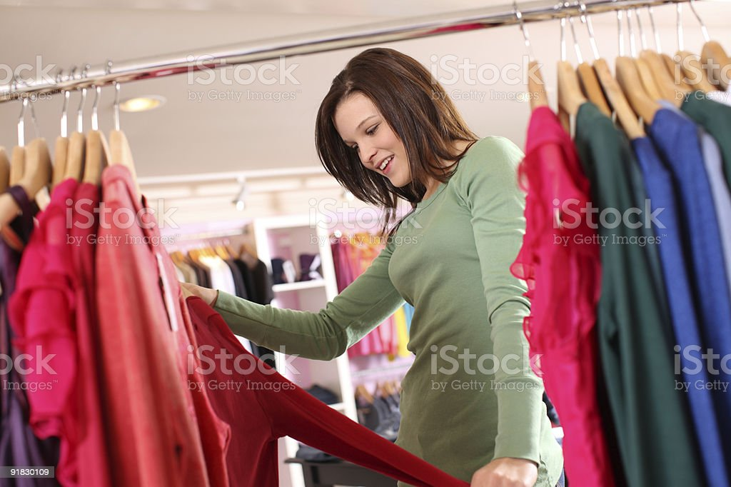 Young woman shopping at clothing store royalty-free stock photo