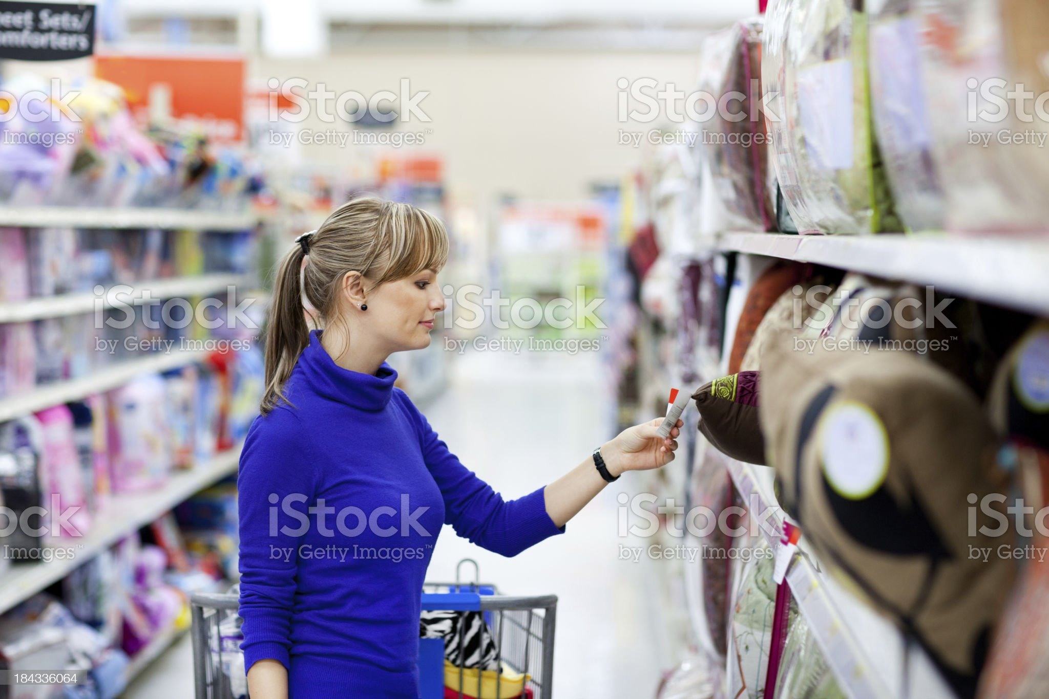 Young woman shopping at large store royalty-free stock photo