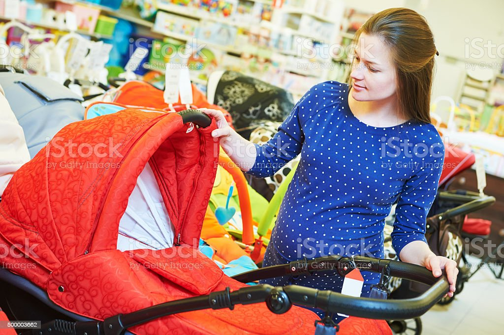 young woman shopping during pregnancy stock photo