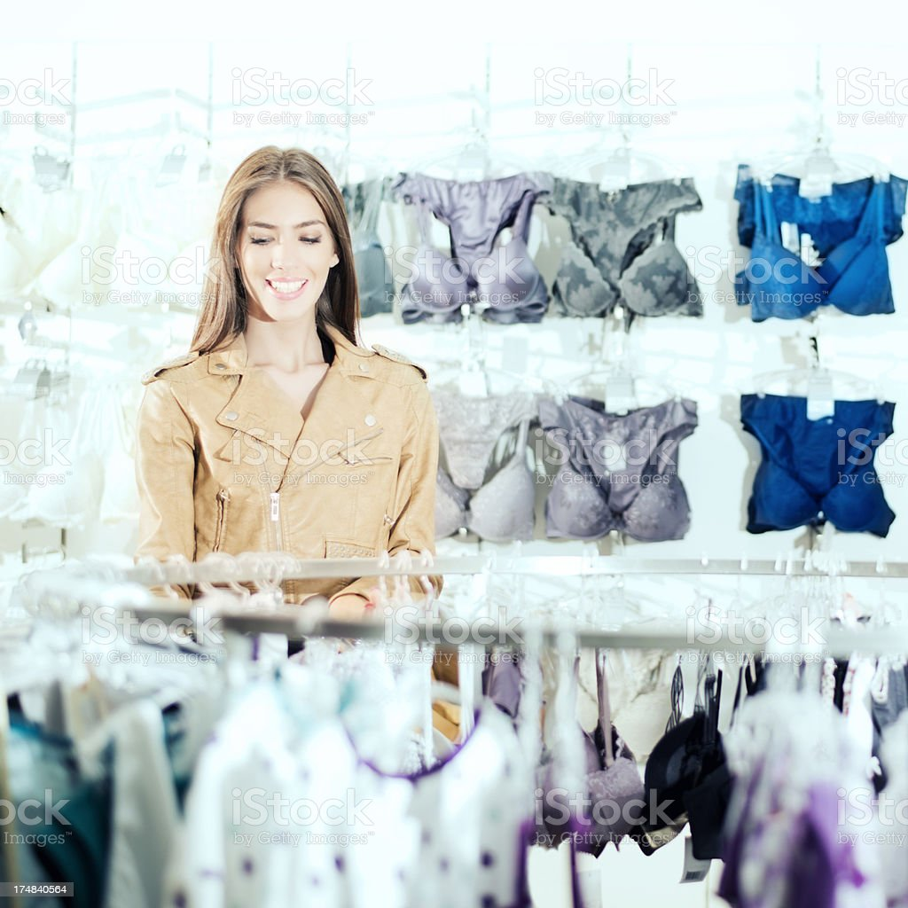 Young woman shopping for bra. royalty-free stock photo