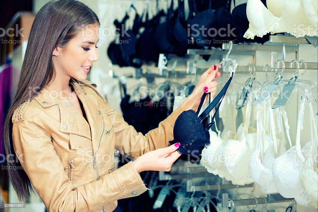 Young woman shopping for bra. stock photo