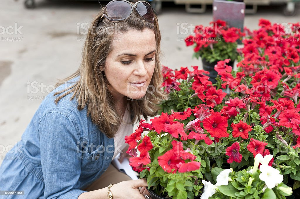 Young woman shopping for flowers royalty-free stock photo