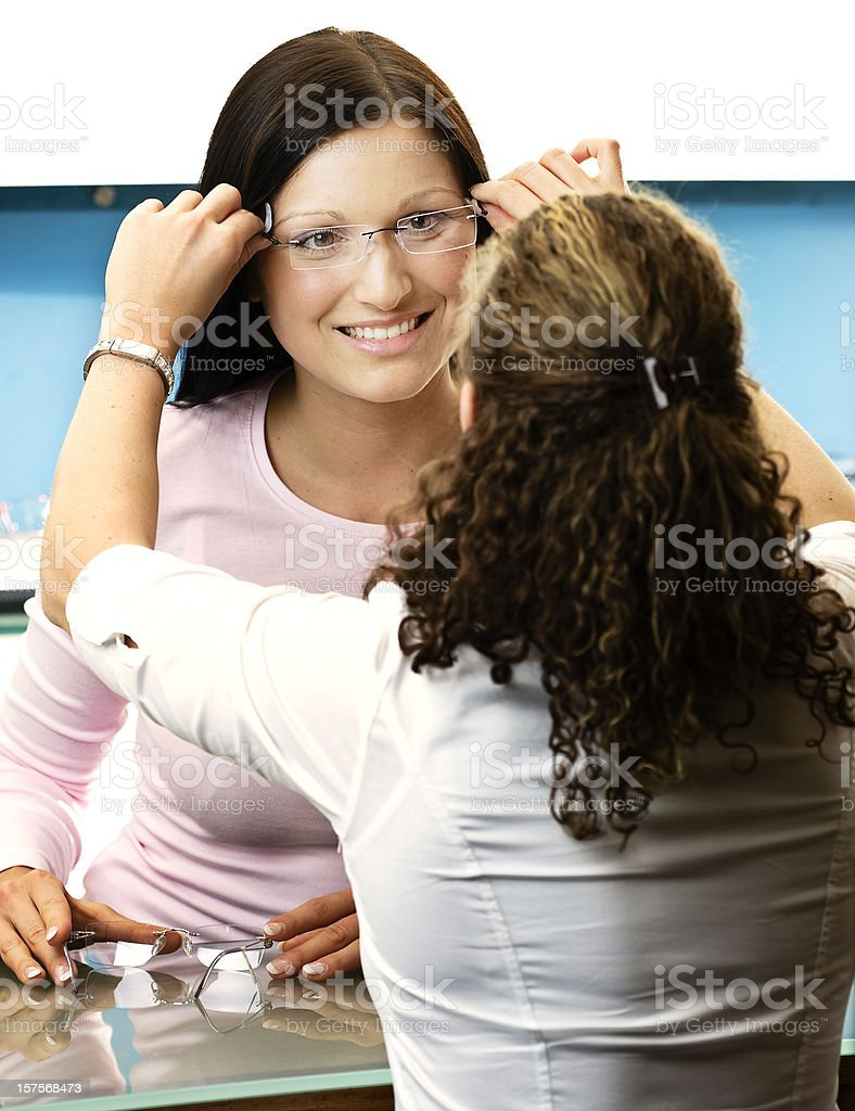 Young Woman Shopping for New Glasses stock photo