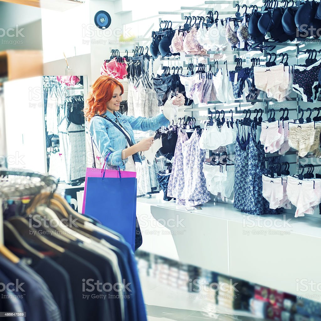Young woman shopping for the lingerie. stock photo