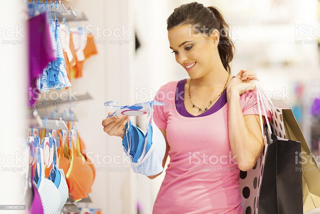 young woman shopping for underwear stock photo