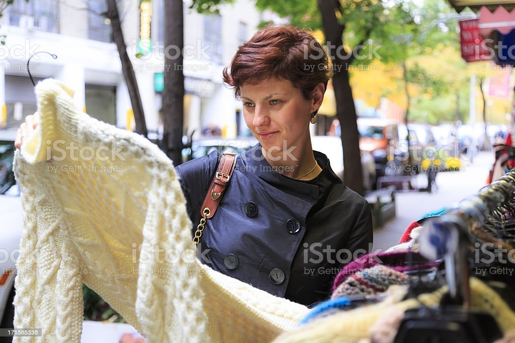 Young woman shopping for vintage clothing royalty-free stock photo