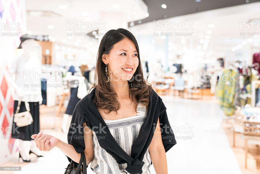 Young woman shopping in a department store stock photo