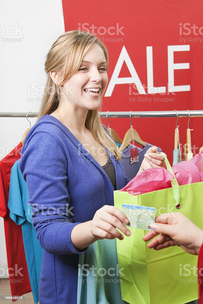Young Woman Shopping in a Fashion Sale with Credit Card royalty-free stock photo