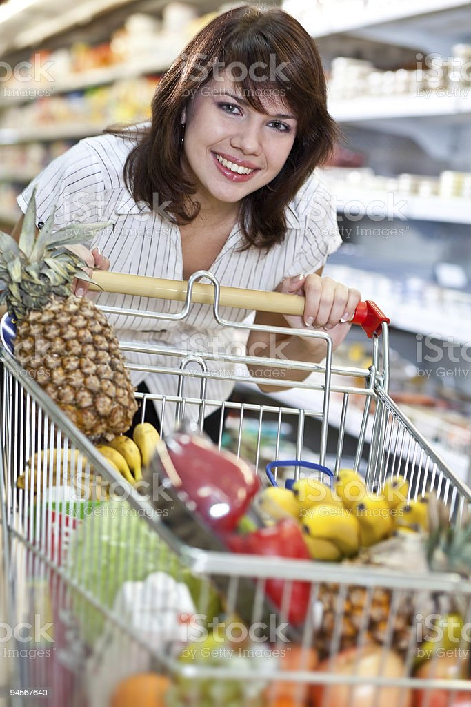 A young woman shopping in a supermarket royalty-free stock photo