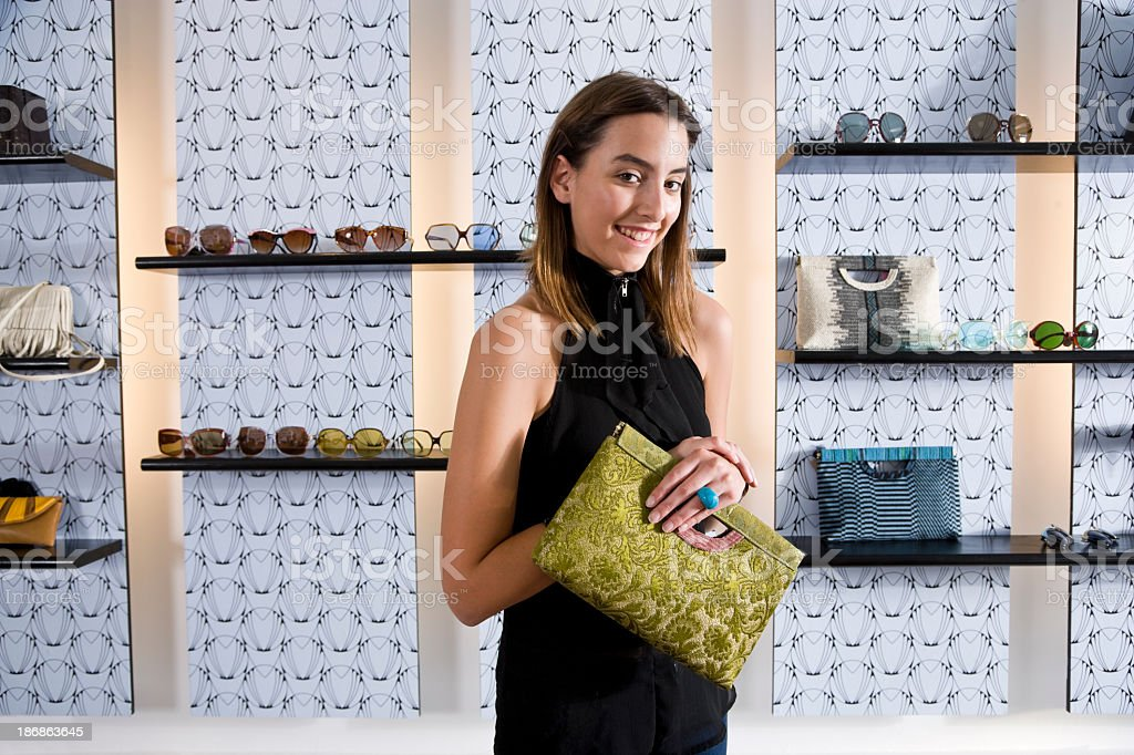 Young woman shopping in boutique for clothing accessories royalty-free stock photo