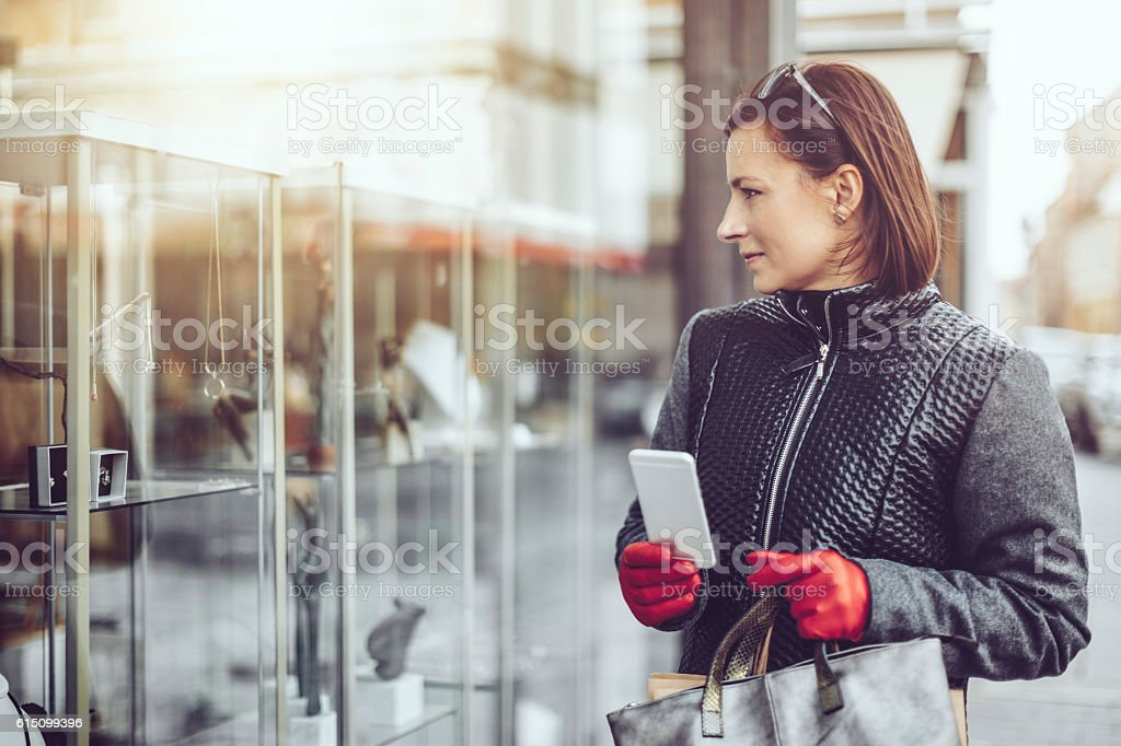 Young woman shopping in the city stock photo