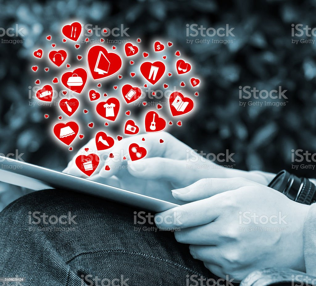 Young woman shopping online by using digital tablet stock photo