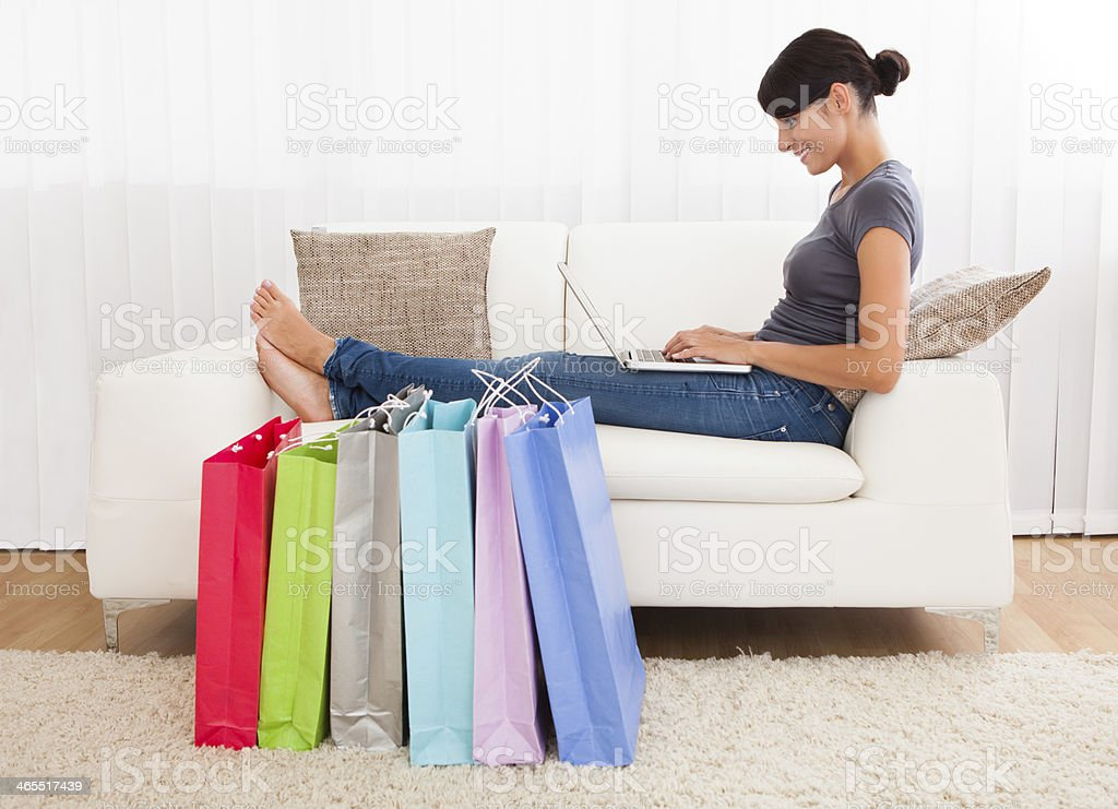 Young Woman Shopping Online stock photo