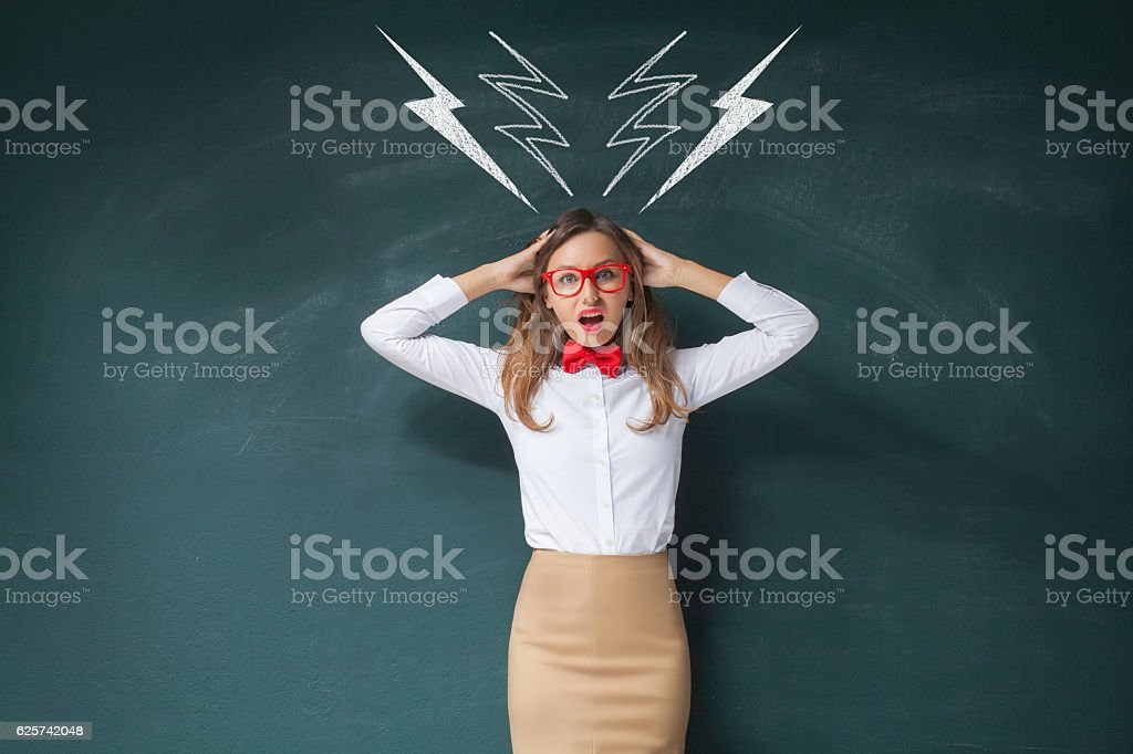 Young woman shouting and standing under drawn lightnings over ch stock photo