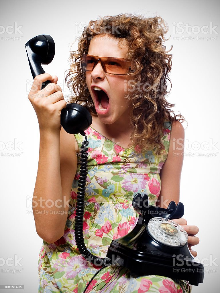 Young Woman shouting into telephone royalty-free stock photo