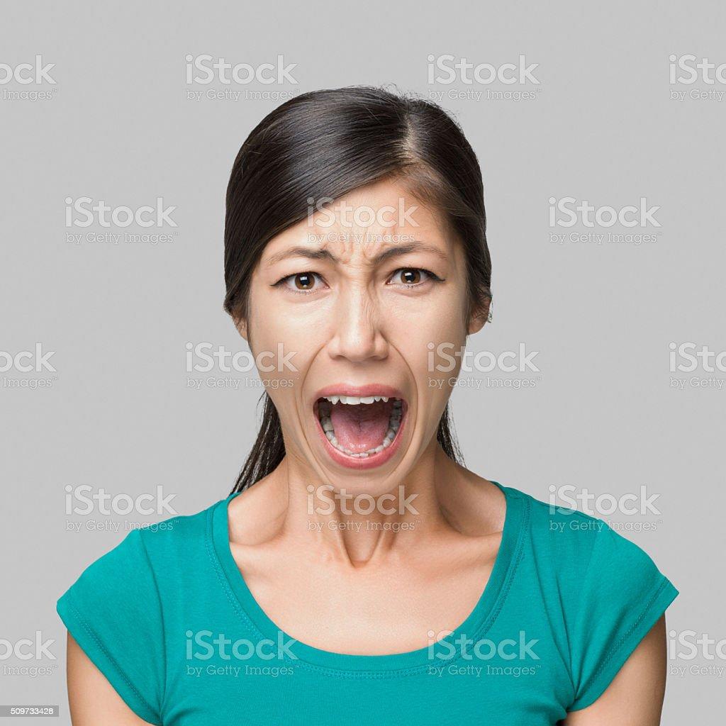 Young woman shouting stock photo