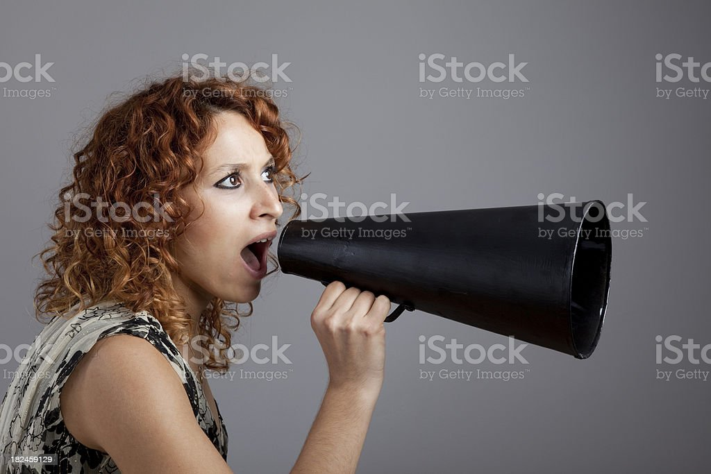 Young woman Shouting With Megaphone royalty-free stock photo