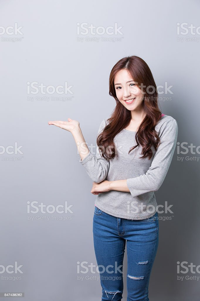 Young woman show something stock photo