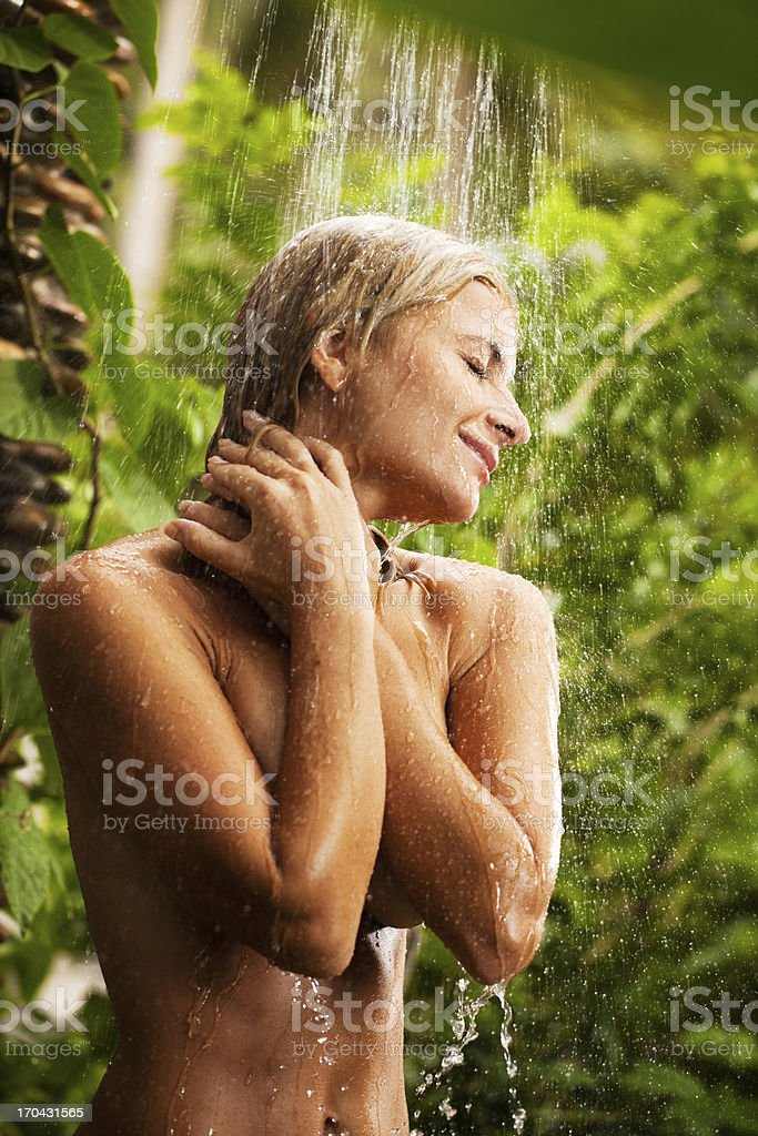 Young woman showering outdoor. royalty-free stock photo