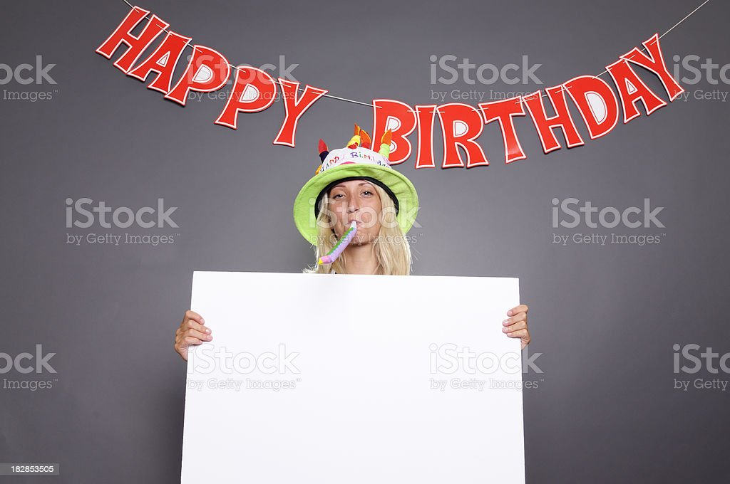 Young Woman Showing Blank Billboard under Happy Birthday Sign.Copy Space royalty-free stock photo