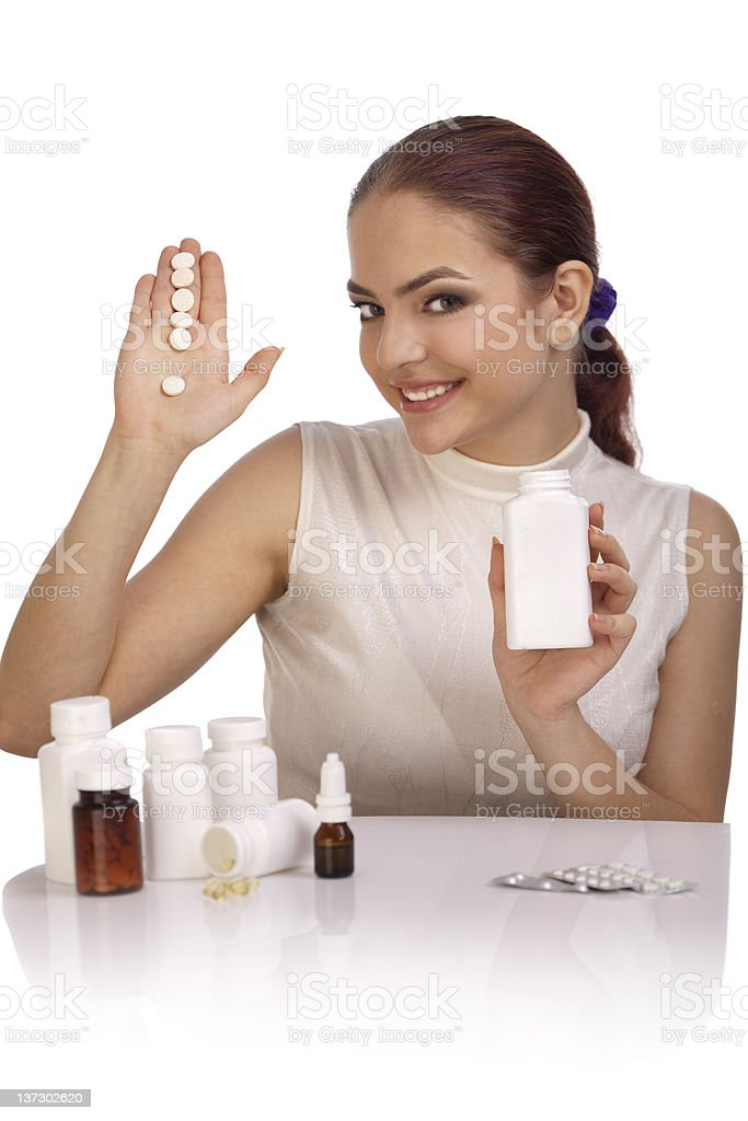 Young woman showing exclamation mark made from pills. royalty-free stock photo