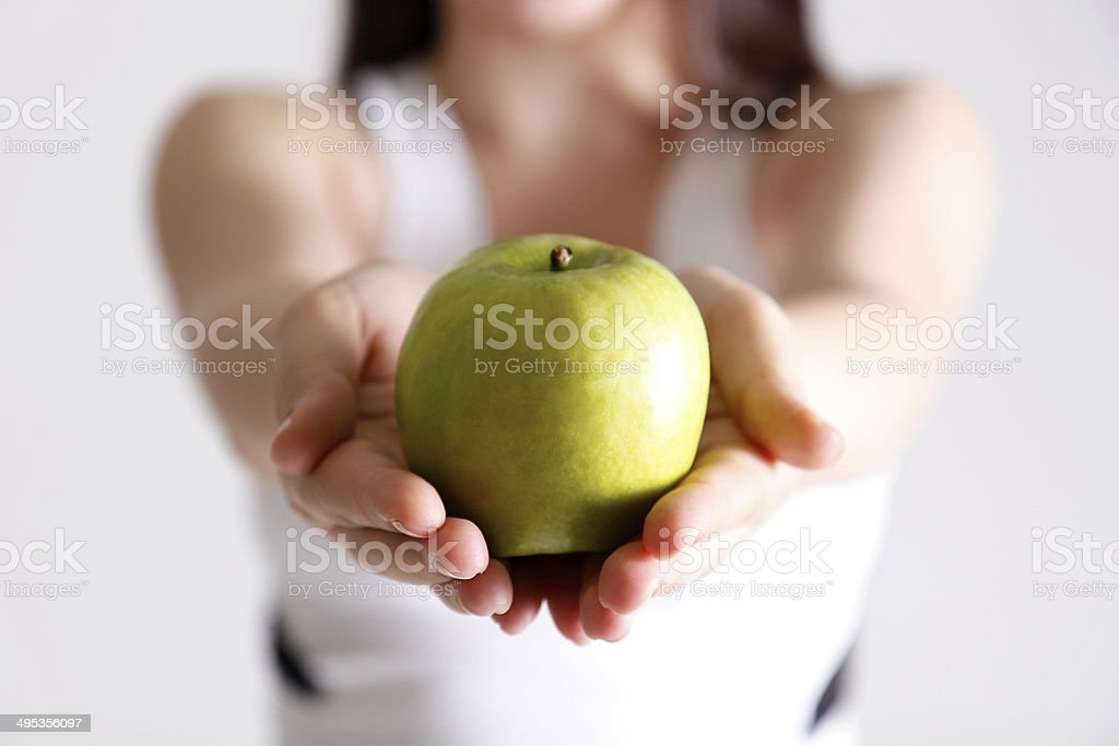 Young Woman Showing Green Apple royalty-free stock photo