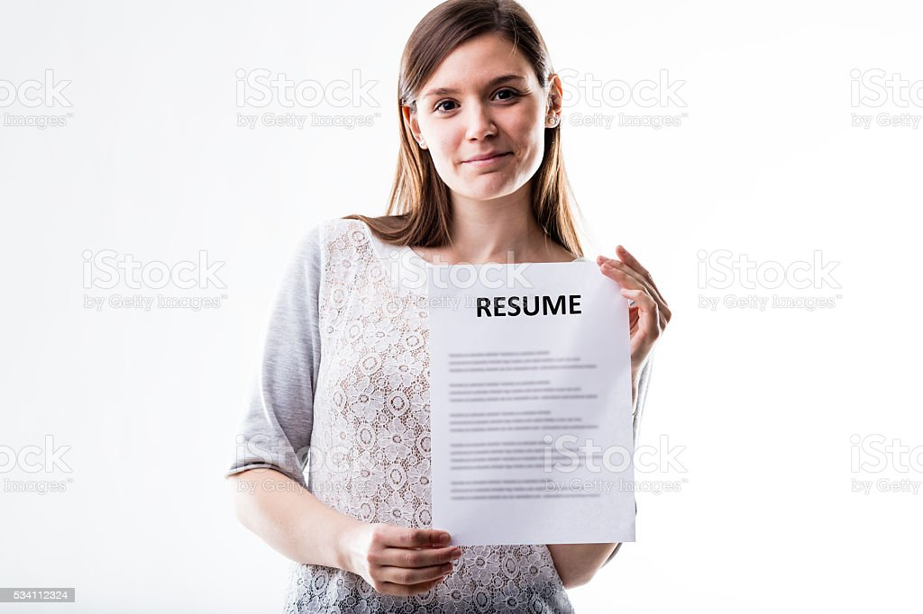 young woman showing her curriculum vitae stock photo