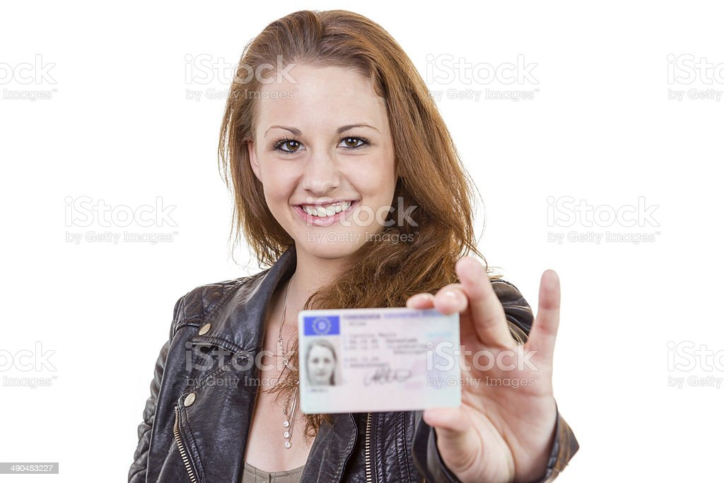 Young woman showing her driver's license stock photo