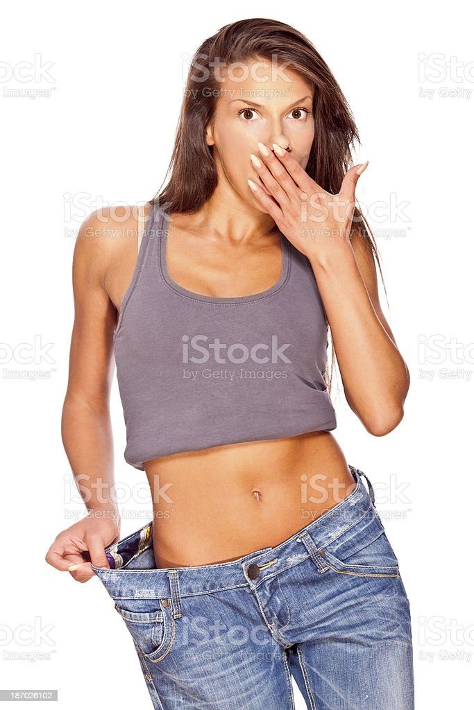 Young woman showing her perfectly fit abdomen royalty-free stock photo