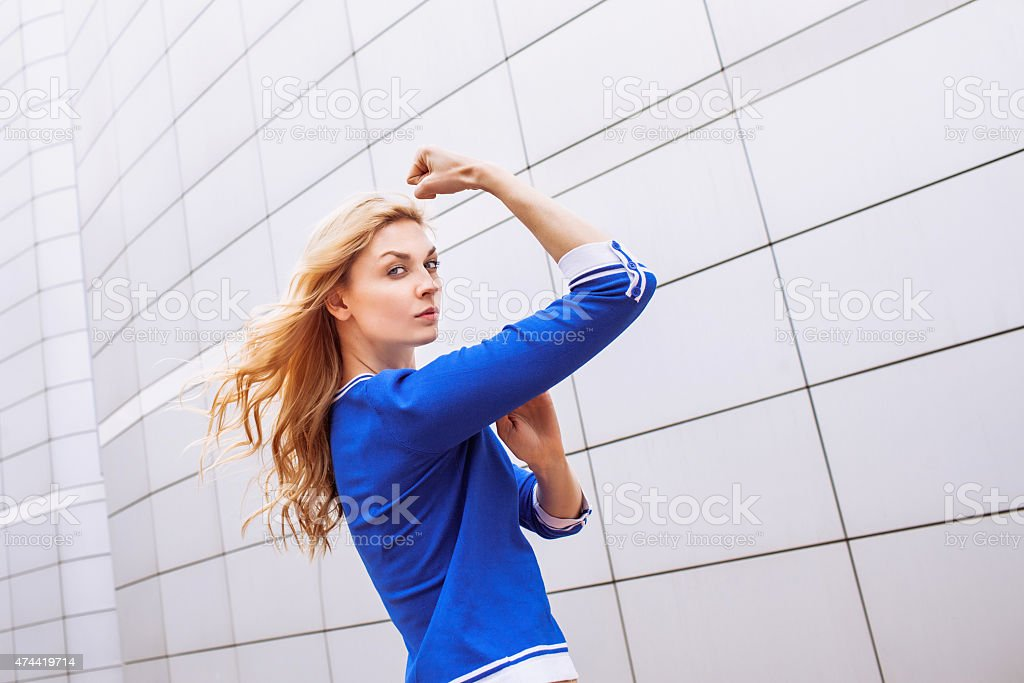 Young woman showing her strength stock photo