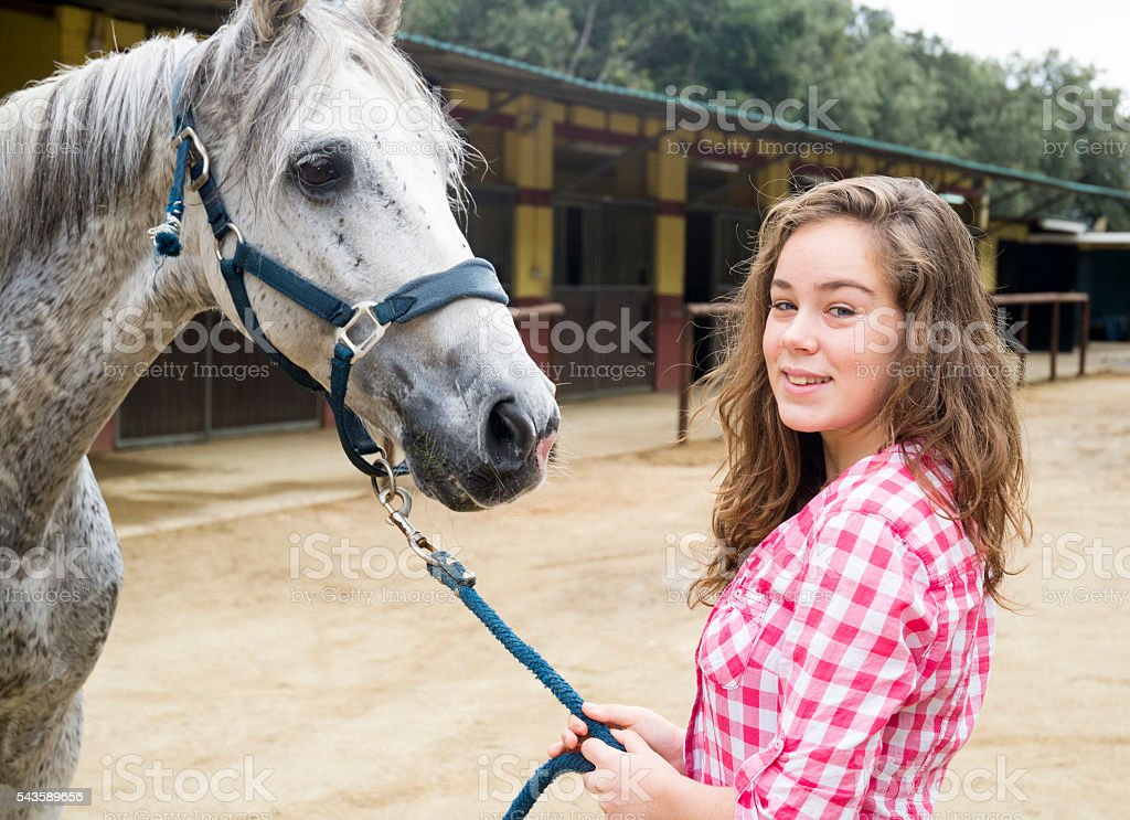 Young woman showing his horse stock photo