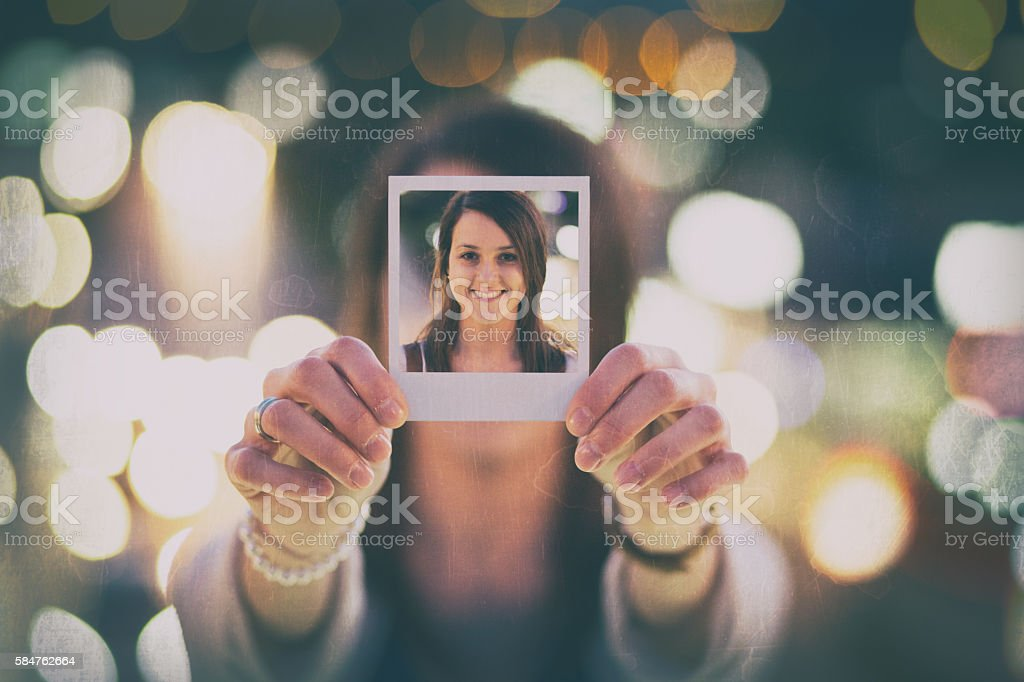 Young woman showing instant selfie stock photo