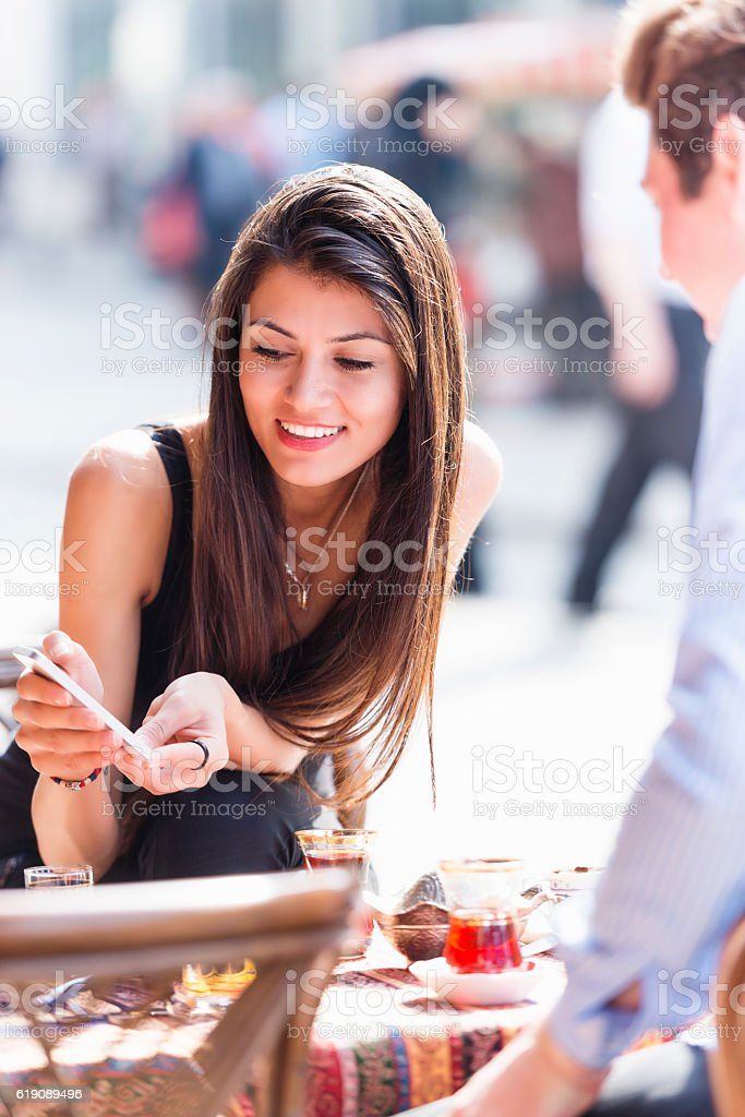 Young woman showing mobile phone stock photo