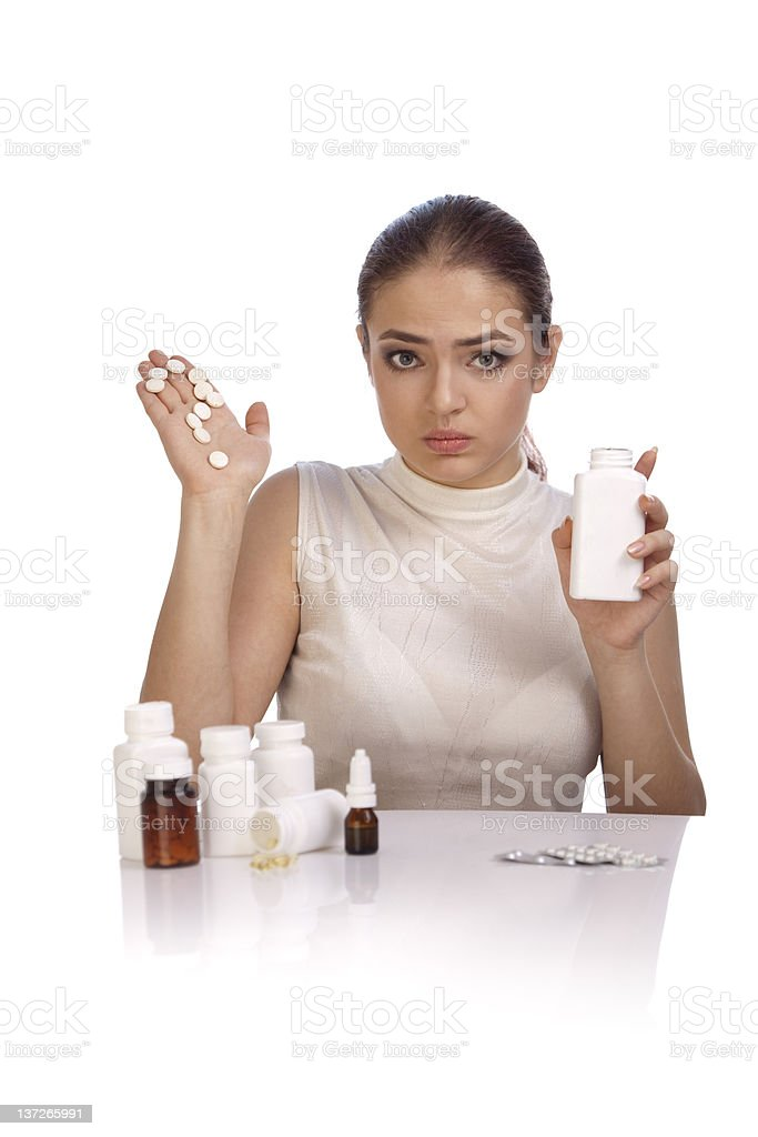 Young woman showing question mark made from pills on  palm. royalty-free stock photo
