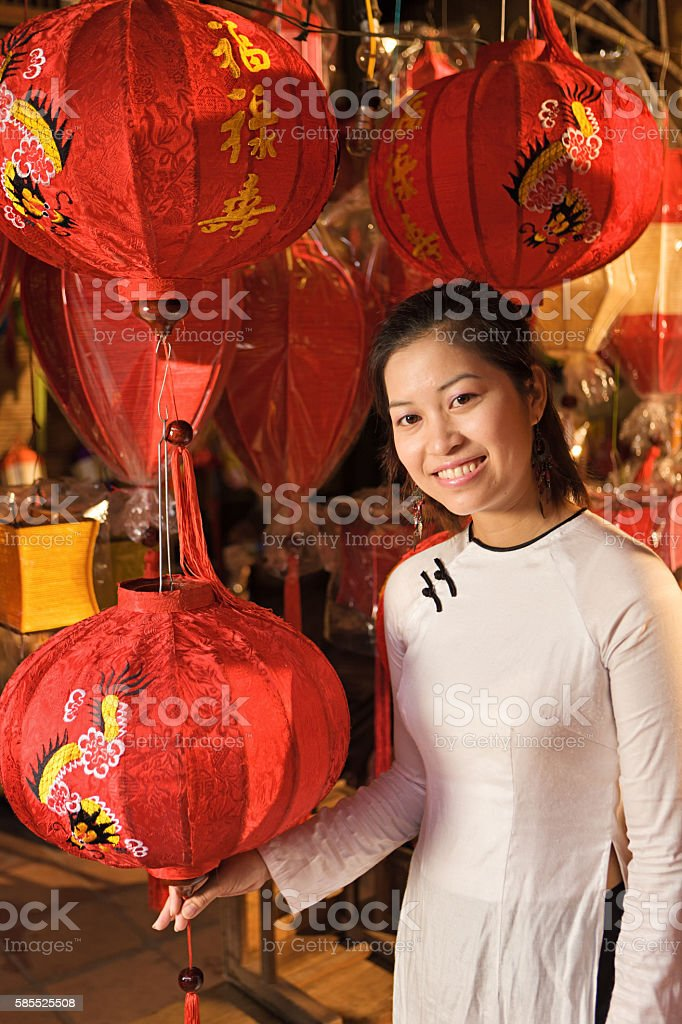 Young woman showing silk lanterns in Hoi An city, Vietnam stock photo
