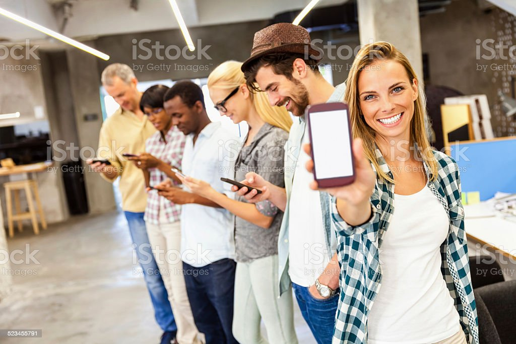 Young woman showing smart phone stock photo